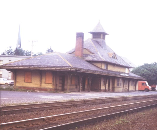 Station at Cobleskill, about 1970. While the station is decidedly run down, the tracks look well cared for and shiny. View is looking at the west (railroad south) end.