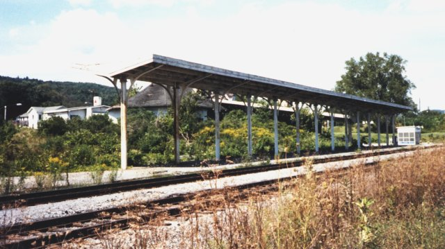 """Platform shelter as seen from trackside, looking north, 1993. Note the tiny """"Amshack"""" at the north end."""