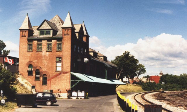 """Plattsburgh depot looking north. Definitely showing the """"French Provincial"""" influence in the design, as evidenced by the numerous corner towers and spiked tops on the tower roofs."""