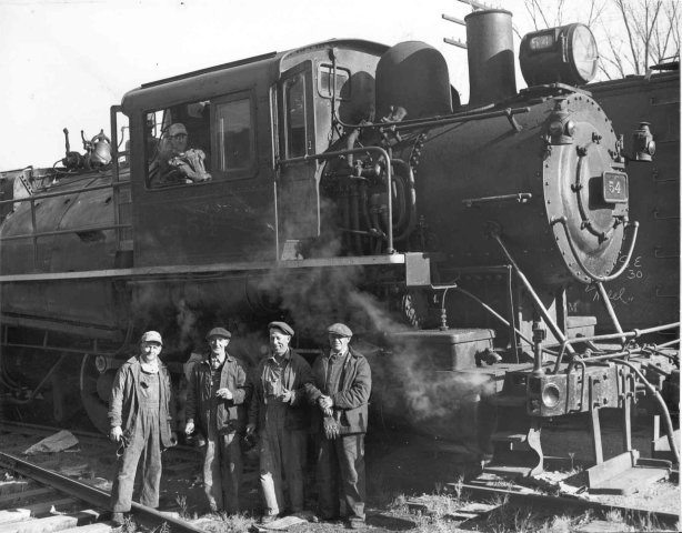 "D&H 54 TYPE:  0-6-0  CLASS:  B-4a  NOTES:  Manufactured by ALCo, Dickson Works for the Delaware & Hudson in 1907 and was gone from the roster by January of 1946. ""A picture of my Uncle Ned Purington on the left, with the steam engine, just before retirement. My uncle died in 1959 and lived in Gansfort, N.Y""   (provided by Wendell Purington)"