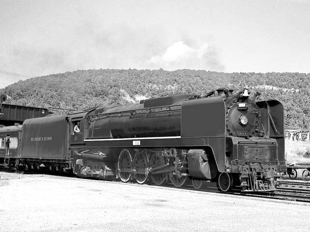 D&H 311 TYPE:  4-8-4  CLASS:  K  DATE:  9/1/47  LOCATION:  Whitehall, NY  NOTES:  Arriving with southbound Laurentian. Built by Alco-Schenectady in 1943, Sold to Luria in August, 1953.  PHOTOGRAPHER:  Jim Wright