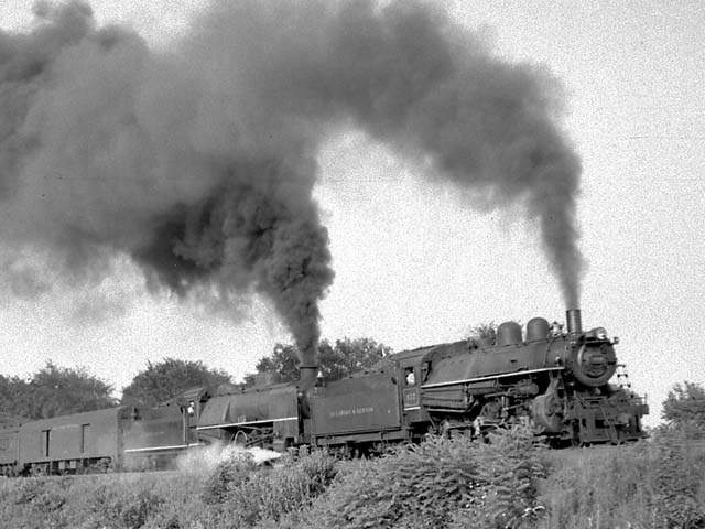 D&H 537 TYPE:  4-6-0  CLASS:  D-3b  DATE:  8/1/47  LOCATION:  Fort Edward, NY  NOTES:  Double heading with 653; the 537 led the southbound train from Lake George; the 653 was added for the mainline run to Troy, where the New York Central will forward the train to Grand Central.  PHOTOGRAPHER:  Jim Wright