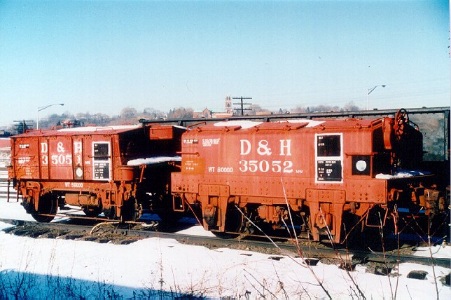 D&H 35051 & 35052  Two of the D&H's three test weight cars sit at Kenwood Yard in January 1988.  Bill Mischler slide, used by permission.