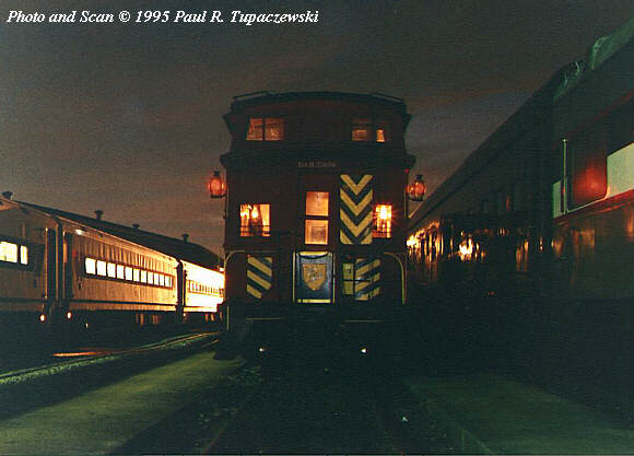 D&H 35886  1995 in Hoboken, NJ. Whippany Railway Museum President Steve Hepler's Delaware & Hudson wood caboose reposes in the cool night air, prior to leaving Hoboken Festival that evening.  Photo by Paul R. Tupaczewski.