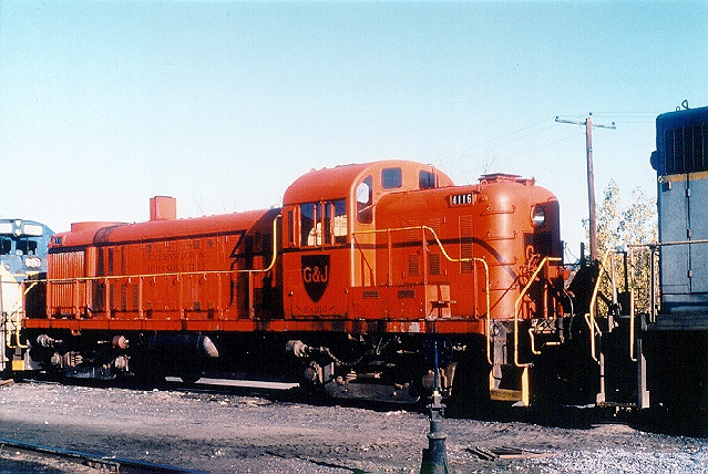 D&H 4116  Painted for D&H subsidiary Greenwich & Johnsonville, shown marshalled between two D&H-painted locos at Mechanicville in October 1981.  Bill Mischler photo