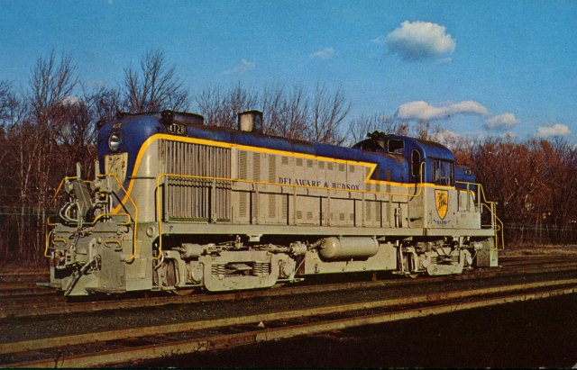 D&H 4128  Typical of one of the popular types of locomotives in the first generation of dieselization was the ALCo road switcher, the 1600 hp RS-3. Unit #4128, built in Aug, 1953, was the second to the last of the 130 road units that ended the age of steam on the D&H. November, 1971.  Jim Shaughnessy photo