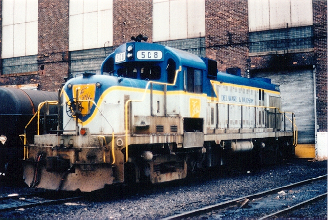 D&H 508  Unit #508 is a little the worse for wear, shown at Colonie, NY, awaiting an overhaul in February 1981.  Photo by Neil C. Hunter.