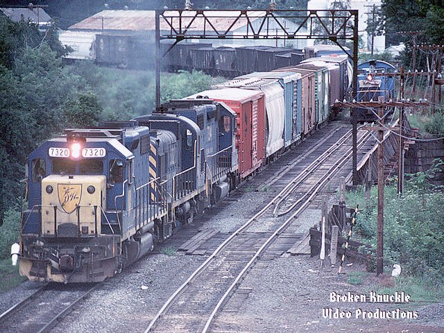 D&H 7320  Photograph of D&H GP38-2 #7320 passing.  Photograph by Ken Buckman,