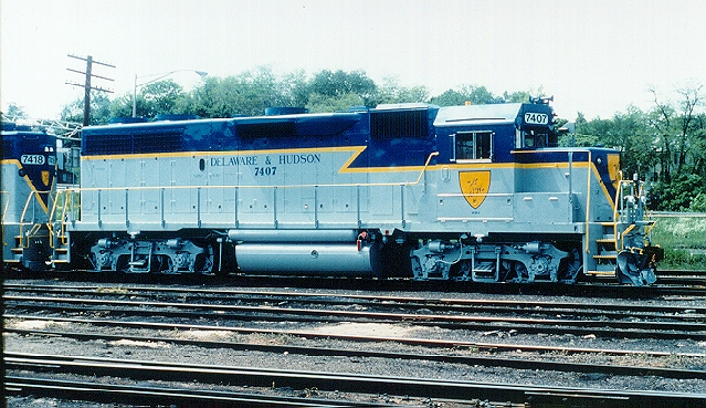 D&H 7407  Sporting a brand new paint job, unit #7407 (and sister #7418) are shown in the final D&H paint scheme at Kenwood Yard, Albany, NY in May 1990.  Bill Mischler photo