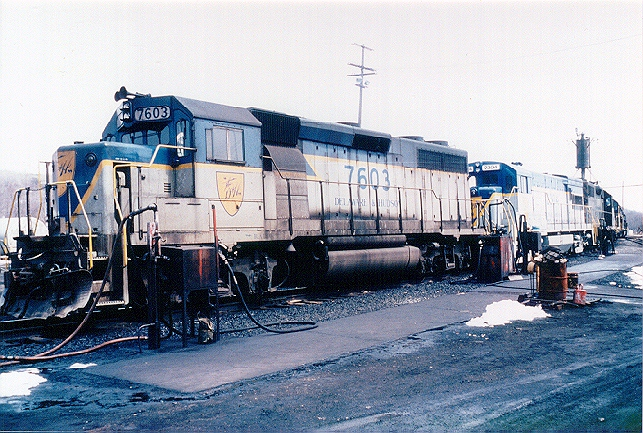 D&H 7603  Unit #7603 is shown at the refueling point at Mechanicville, NY in April 1982, sporting a revised lightning stripe scheme with large side numbers.  Bill Mischler photo