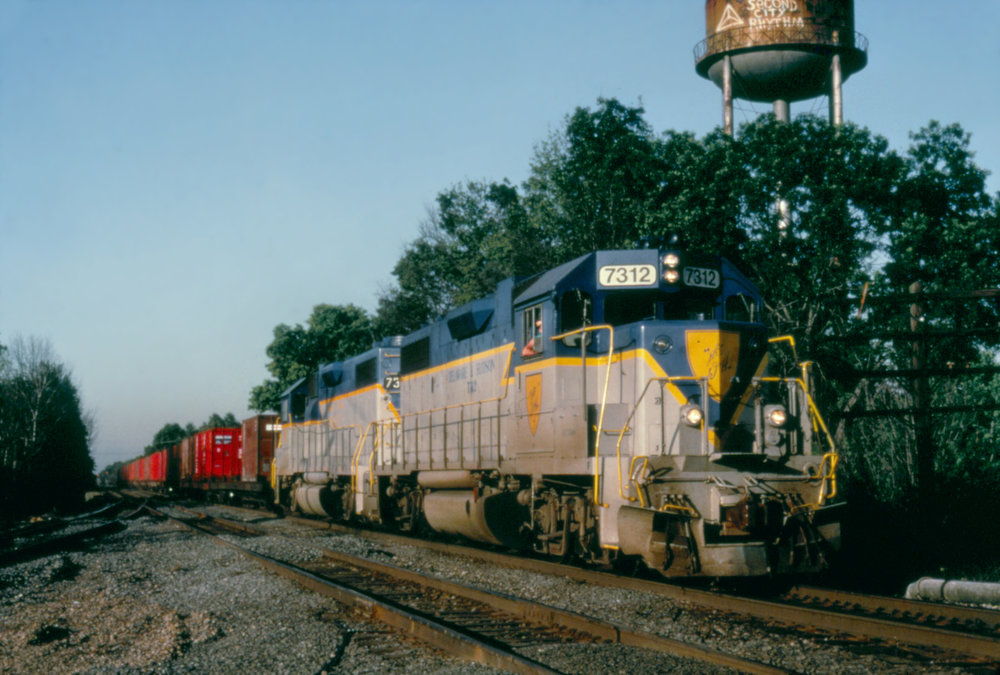D&H (now CP) #7312 leads a D&H run-through train over Conrail in Aldene, NJ on July 2, 1992.  The Garbely Publishing Company collection