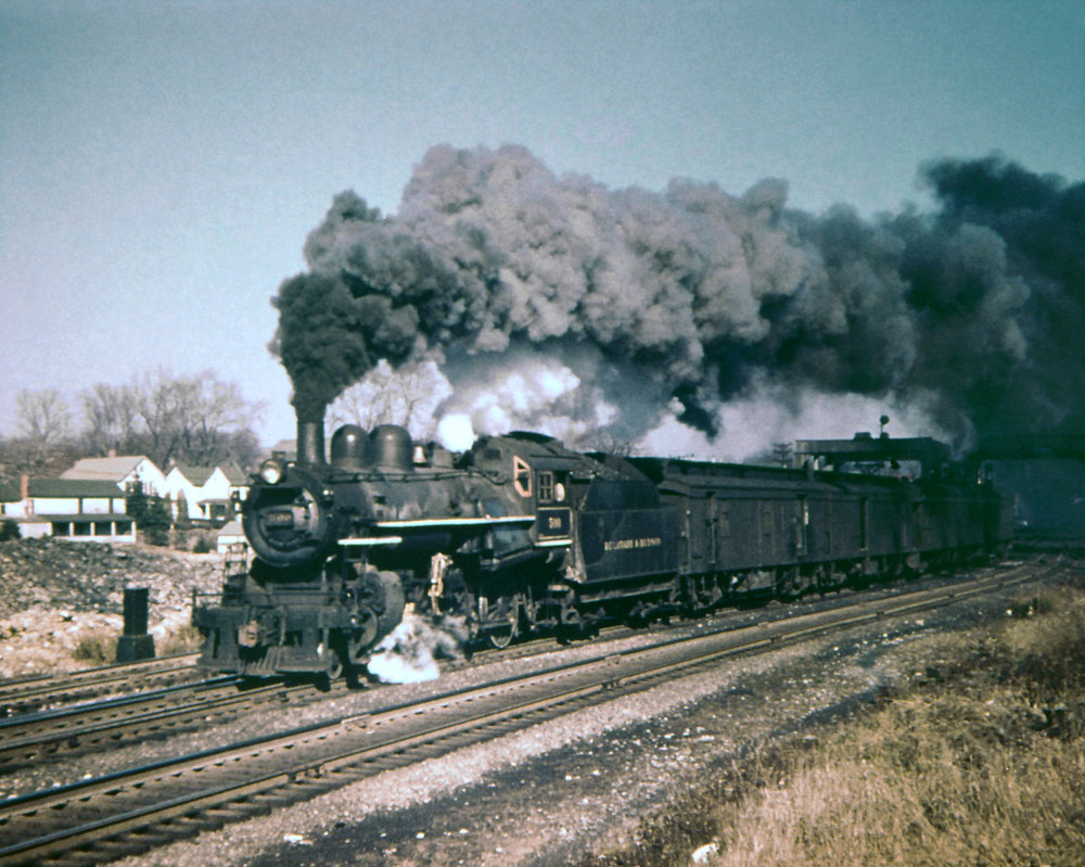 D&H class D-3 4-6-0 #500 blasts through Carbondale, PA on November 9, 1951.  Bob Collins photo, The Garbely Publishing Company collection