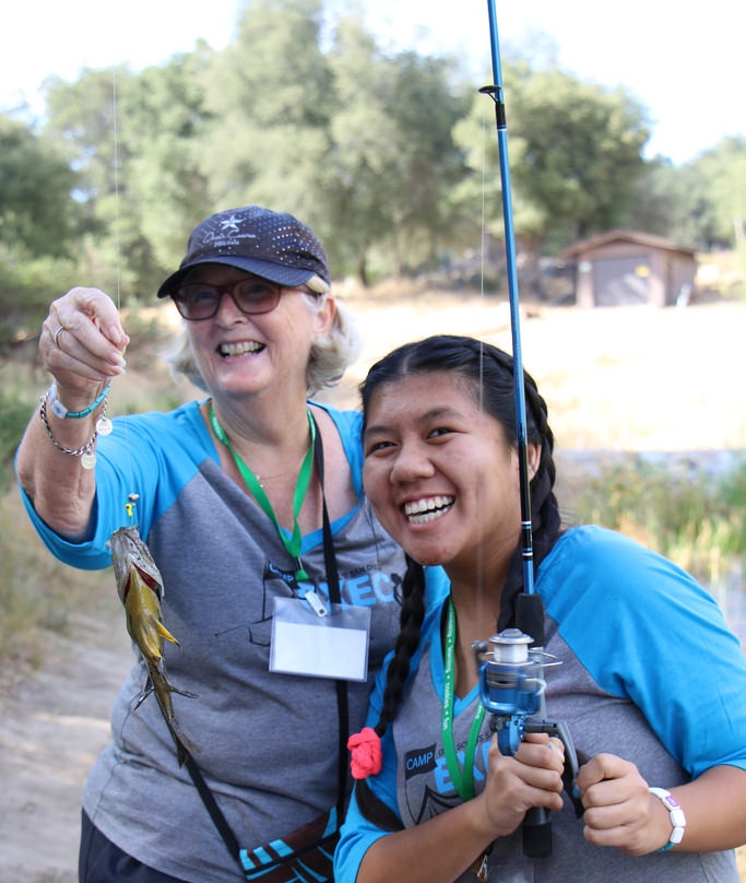 A mentor and mentee wearing their Spark bracelets at camp.