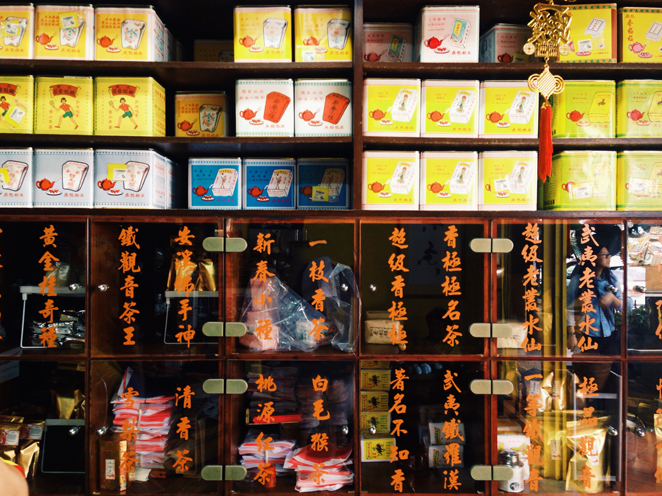 Right wall of the shop is stacked with teas from floor to ceiling.