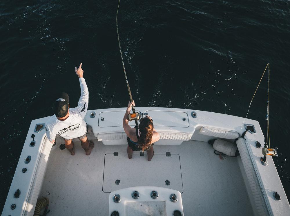 looking down pointing at fish.jpg
