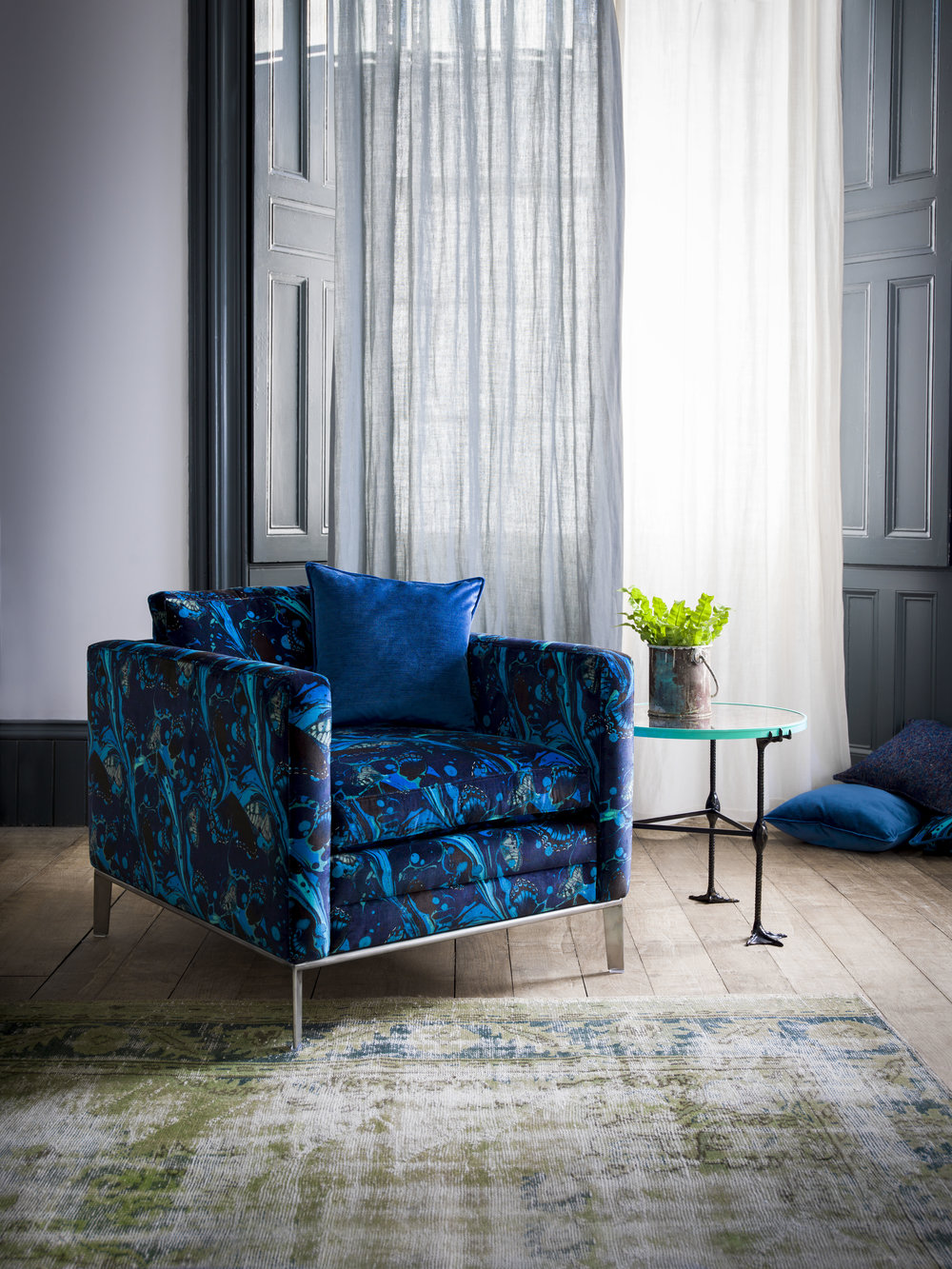 DURESTA-l-Minnelli-Chair-in-Marble-Butterfly-Electric-Blue-£1849-with-Estelle-Blue-Scatter-Cushion-£63-Lamp-Table-with-Solid-Lacquer-Top-£2277.jpg