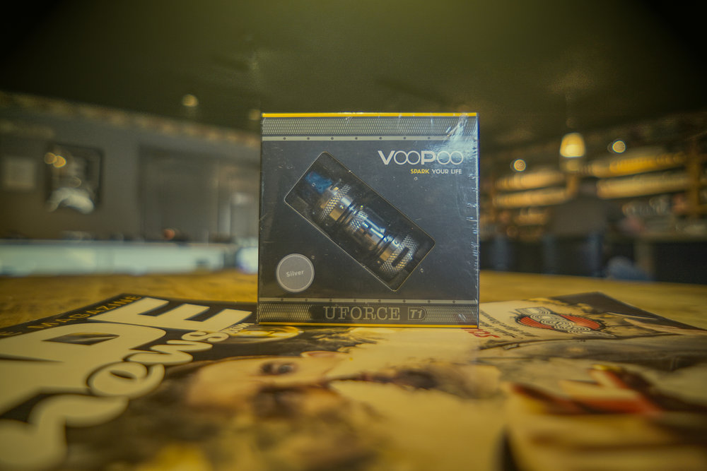 VooPoo UFORCE T1 Sub-Ohm Tank   VooPoo introduces the new and improved UFORCE T1 Sub-ohm Tank, a sub-ohm tank with an upgraded venting system and triple airflow, an upgraded 8ml max capacity with knurled designs. The UFORCE T1 utilizes a quick vent channel to produce huge vapor without heating the tank up too rapidly. The shorter path from the air intake to the outtake will rapidly discharge the heat, users will enjoy great flavors and tremendous clouds without the drip tip over heating.