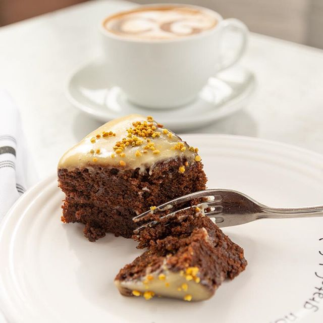 This weekend Gratification members get 50% off our monthly specials: the Honoring chocolate olive oil cake and Active blended mocha, available at Café Gratitude Arts District, Larchmont, San Diego & Venice. Not a Gratification member? Sign up in store, activate your card online, and redeem your discount this weekend.  I am Honoring- a decadent and rich chocolate olive oil cake with honey glaze and bee pollen (contains gluten). I am Active blends espresso, coconut meat, plant protein, dates, almond milk, raw honey, cacao, reishi, shilajit, chaga, he shou wu and bee pollen for an energizing mocha loaded with Fuel, Fat & Fiber.  Available all month long at Café Gratitude Arts District, Larchmont, San Diego & Venice.