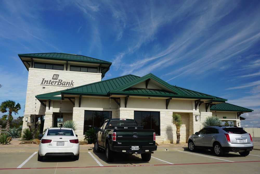 "INTERBANKRed Oak, TX - Manufacturer: MBCIPanel type: 16"" snap lockColor: Hunter GreenAreas worked on: Roof, awnings, gutter system"