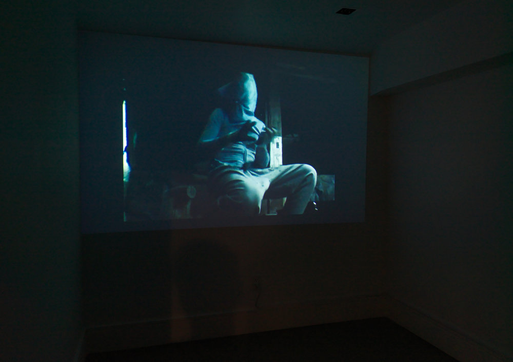 False Flag  installation shot. Harry Dodge and Stanya Kahn,  All Together Now  (2008). Color video with sound. Credit: Object Studies.