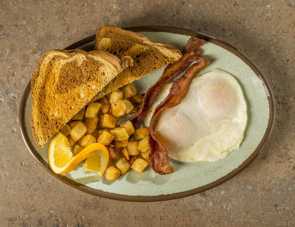 Café Classic - Eggs, choice of meat (bacon, sausage, ham), and toast, with fried potatoes.$7.99