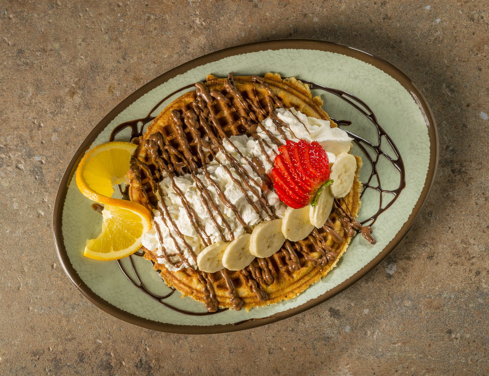 Hazelnut Strawberry - Waffle topped with hazelnut spread, bananas, strawberries, chocolate drizzle and whipped cream.$7.29