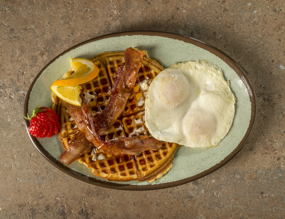Iron Waffle - Waffle with eggs and bacon served with syrup.$9.29