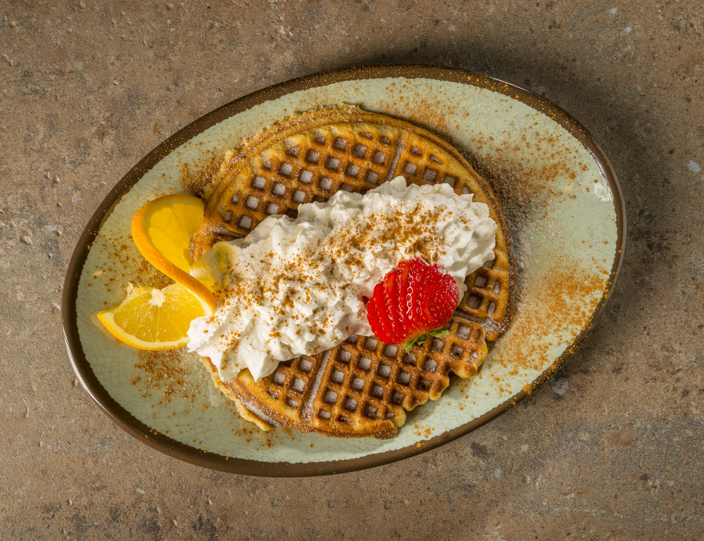 Churro Waffle - Waffle with cinnamon sugar, strawberries, and whipped cream.$7.29
