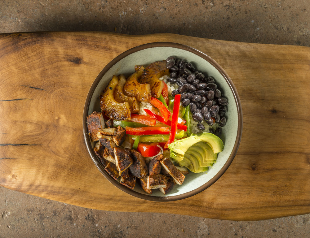 Jerk Chicken Bowl - Grilled jerk chicken, black beans, grilled pineapple, avocado and bell pepper with house-made coconut-lime sauce.$9.79