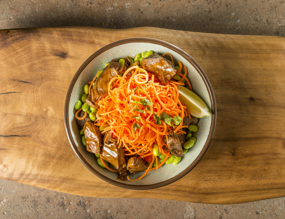 Tokyo Steak Bowl - Grilled flap steak, bell pepper, red onion, cremini mushroom, carrot, green onion, cilantro and edamame beans with house-made spicy teriyaki sauce.$12.49