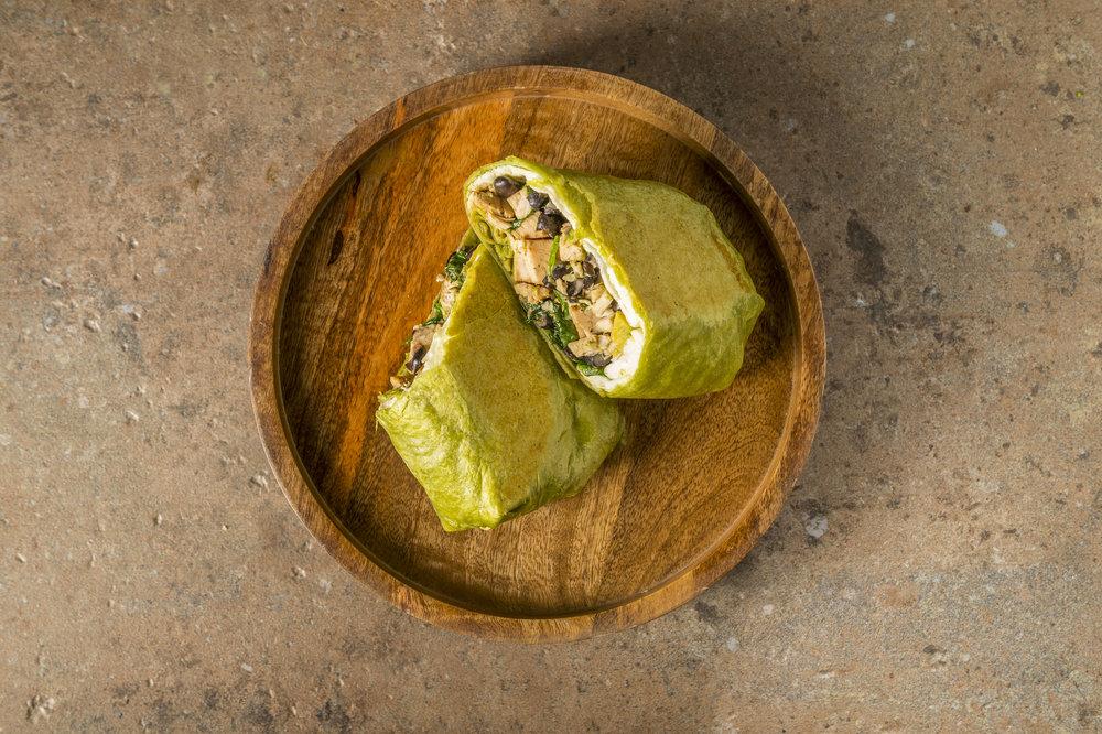 Green Burrito - Our Alfresco Bowl in a spinach tortilla.(Avocado, goat cheese, black beans, cilantro, fire-roasted corn, roasted red pepper, pico de gallo, sour cream & scrambled egg on potatoes)$9.39