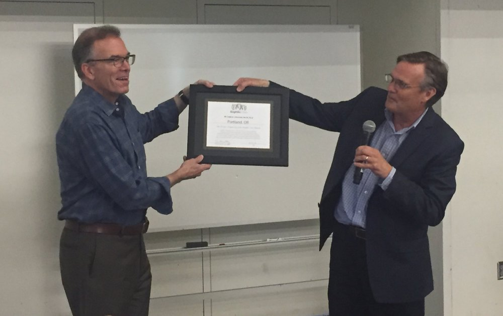 Commissioner Nick Fish receiving recognition of Portland's role in the Biophilic Cities Network.