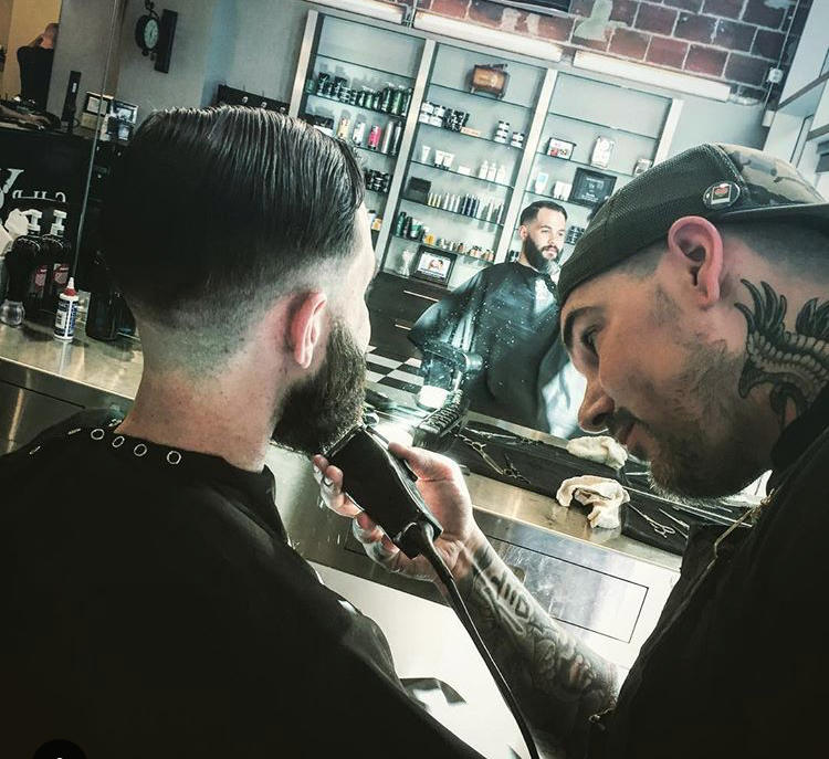 Owner and Barber, Shane Fattarino, doing what he does best.
