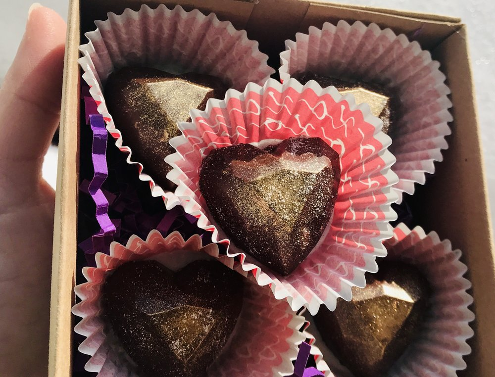 4. Golden Heart Jewel Filled Chocolates - Experience a Heart of Gold… Rich & creamy intertwine for a heavenly experience like no other on Earth! Featuring Stoneground, Sprouted Heirloom Almond Butter Filled Raw Dark Chocolates Dusted with 24K Gold & the option of Pink Himalayan Salt!