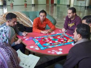 Volunteers play a game