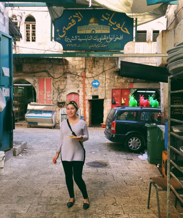 EFL Fellow Catalina enjoys knafeh at a shop in the Old City.