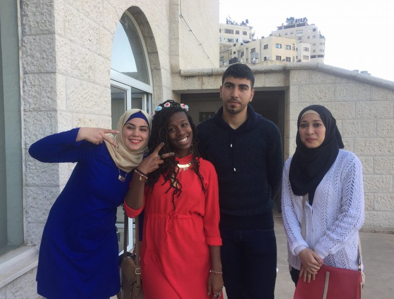 EFL Fellow Mecca and STEP II EFL Students Wurood, Jaber, and Yasmin celebrate together after a successful final performance.