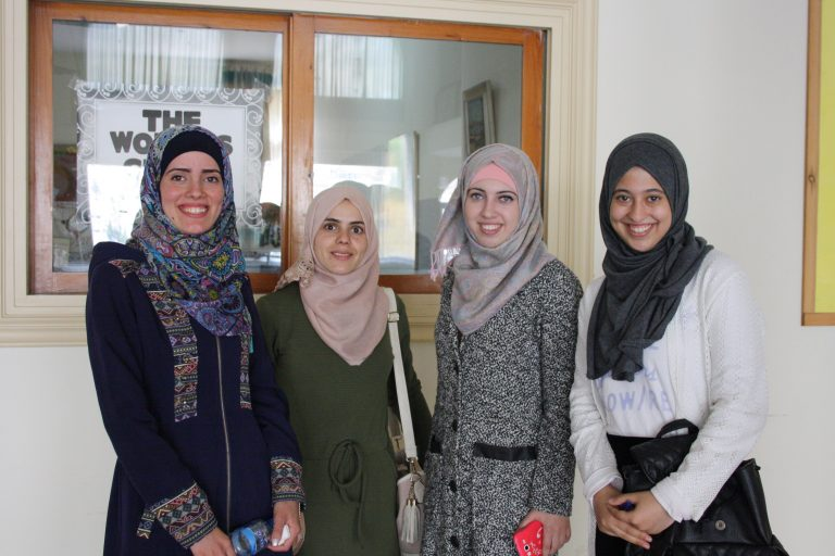 EFL students smile during a break from their English class.