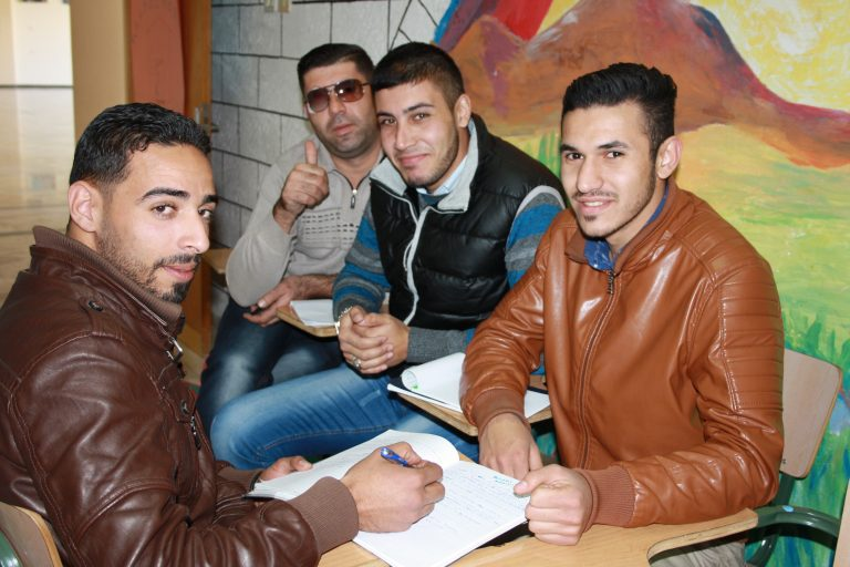 STEP! II EFL students Mahmoud, Mahmoud, Arafat, and Amjed pause during a group activity to give a thumbs up!