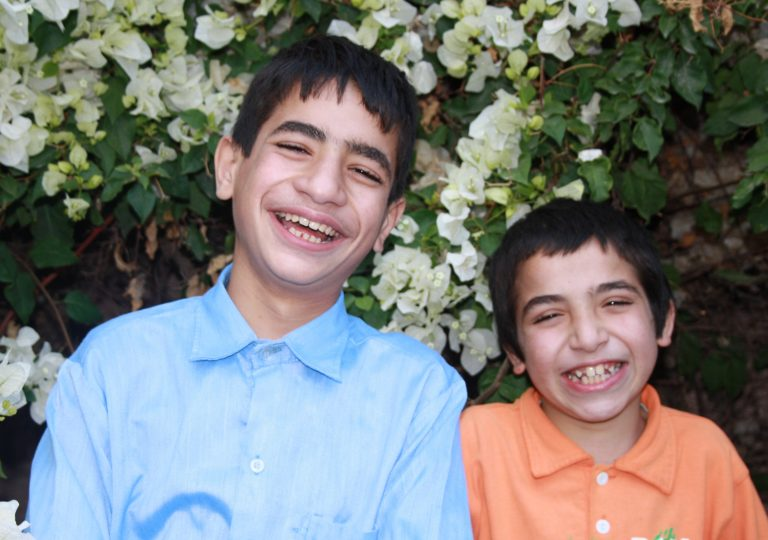 Brothers Mohamed and Abdil share a laugh between classes at TYO.