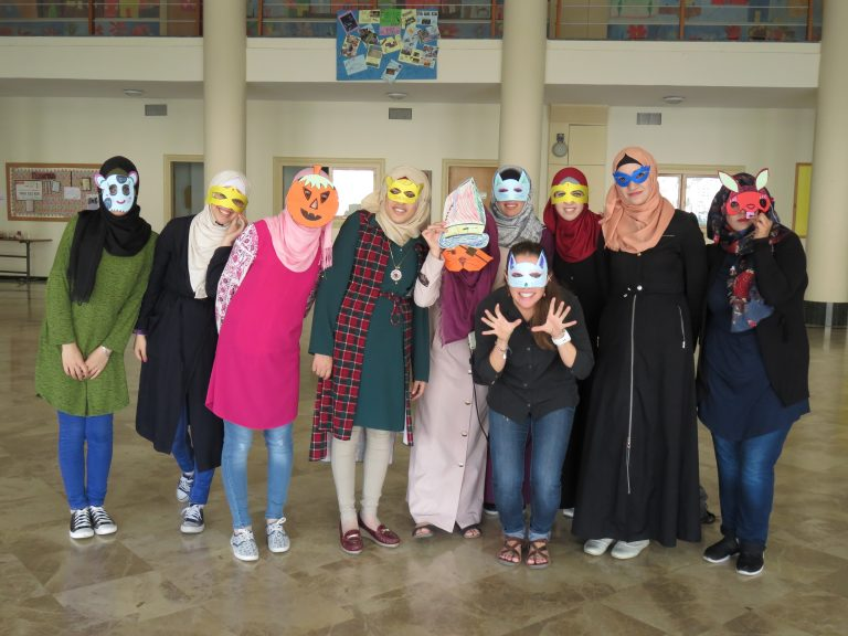EFL Fellow Leah and her class show off their masks created during an EFL class.