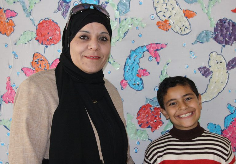 Jenan and her son Salim enjoy their time together at Tomorrow's Youth Organization.