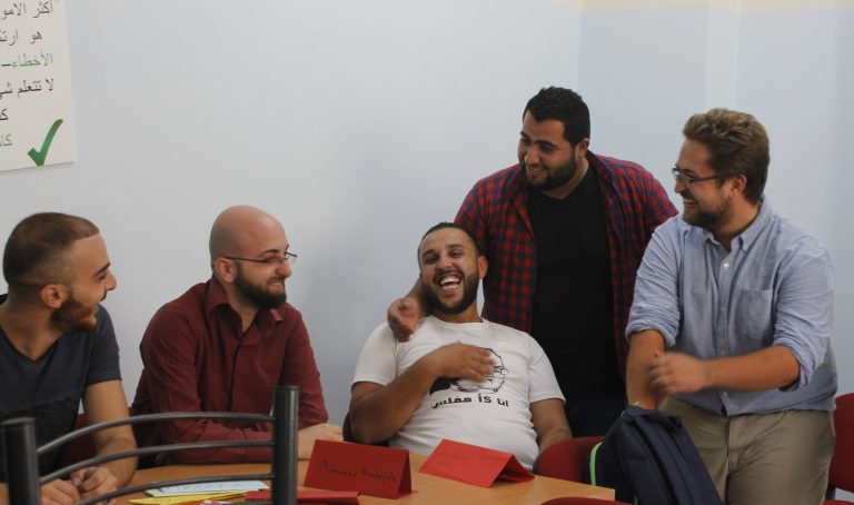 EFL Fellow Mike and his students share a laugh during a STEP! II EFL class.