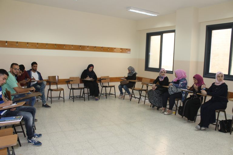 STEP! II EFL students wait for class to begin on the campus of Al Quds Open University.