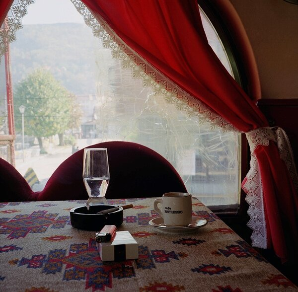 """After the interview M.B., Bosniak, in a Prizren cafe, October 19 2000. """"Fear was our permanent escort from early 1998. The Albanians were the main focus of harassment, but we didn't talk to them much; they didn't trust us – each community had kept fairly separate for the last ten years. I had some Albanian acquaintances, but my closest friends were Bosniak. We met in both Serb and Albanian cafés,, but we weren't trusted by either side. The last Bosniak café closed in April 2000 – we were worried that Albanian groups might throw grenades through the window. Before the war, it was the Serbs who broke the windows of the cafés; after the war, it was the Albanians. So for the last few months we've been to mostly Albanian cafés… We Bosniaks will always be in the minority. With each new regime, we face new hardships. We are like Sisyphus in the Greek myth, pushing the stone up the mountain in vain."""""""