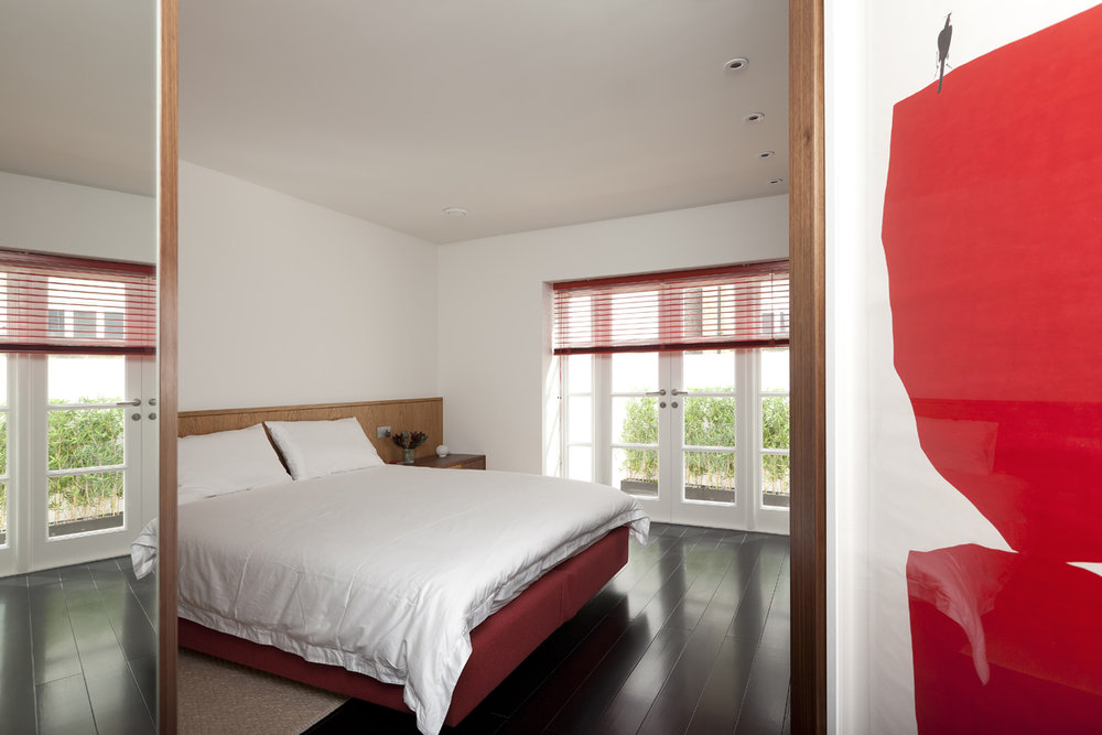 bedroom and red art