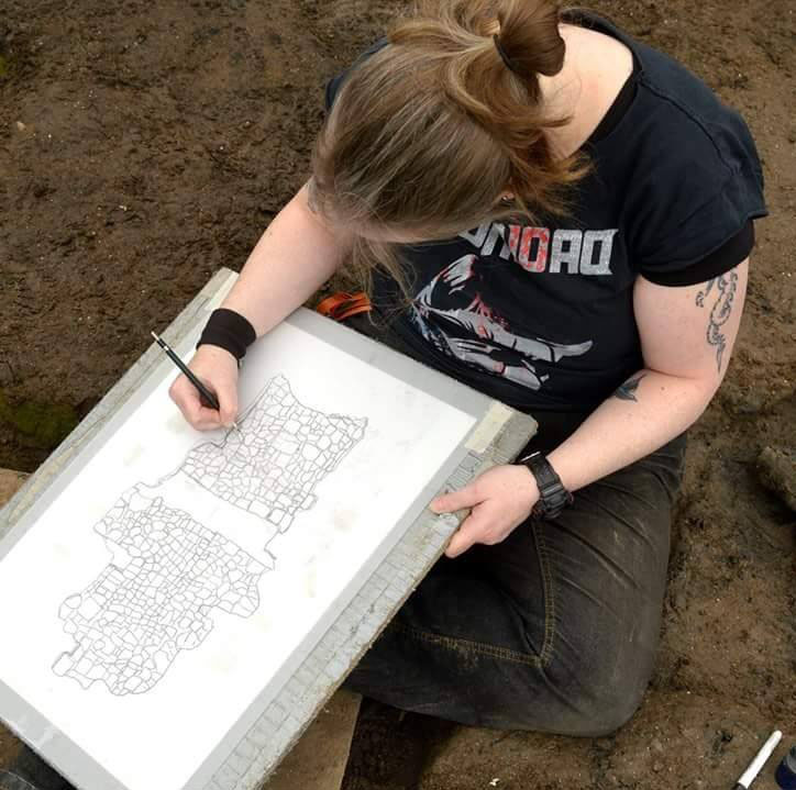 Drawing the remains of a Bronze Age wheel at Must Farm, Cambridge Archaeological Unit