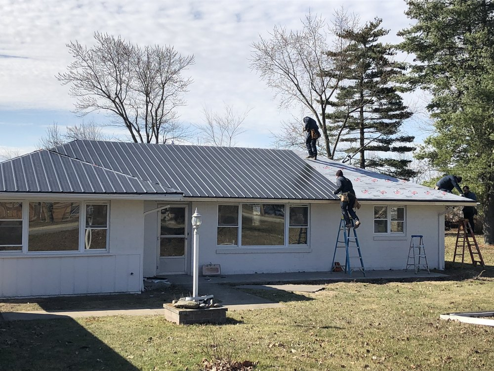 black metal roof and painting brick white