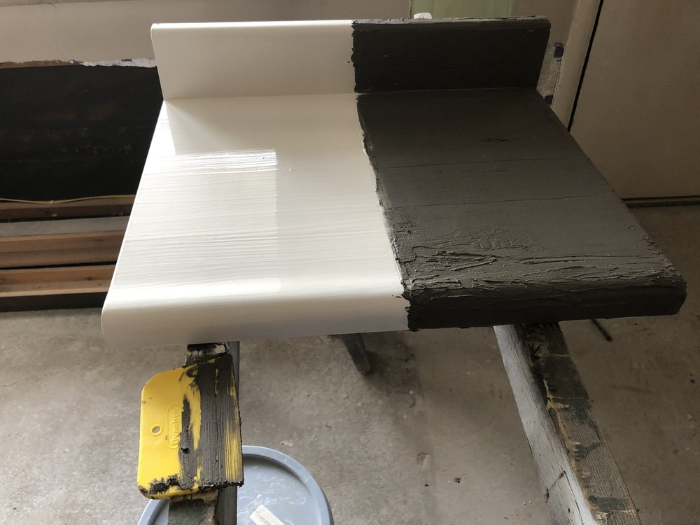 paint on left and ardex feather finish concrete on right