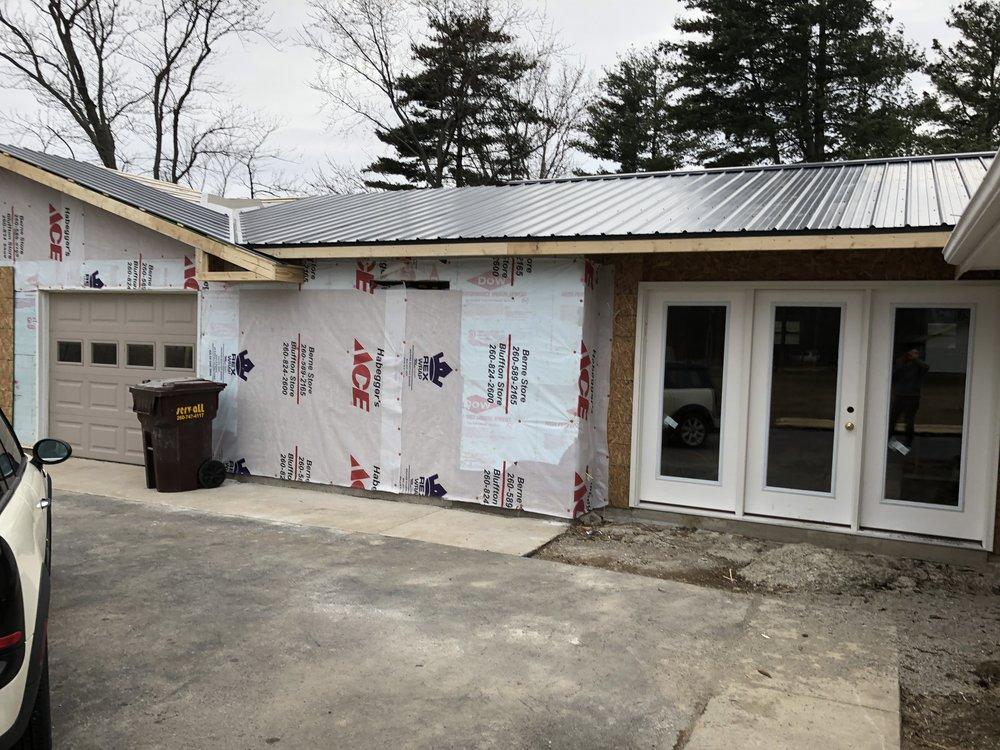 after: metal roof and peak over garage